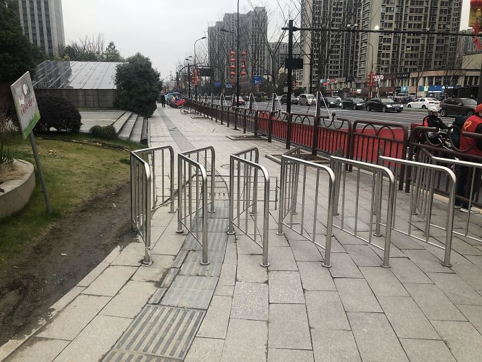 Fences Are Intended To Prevent Bikes From Going On Sidewalk... But They Can Just Go Around It