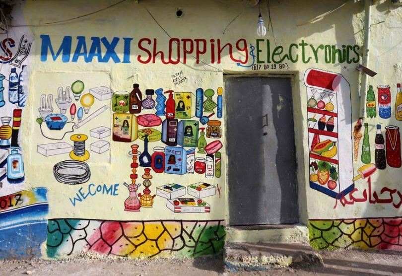 somalia hand painted storefronts 11 5cf4d7422cbf4  880 - Você Sabia? Vitrines na Somália tem que ter desenhos