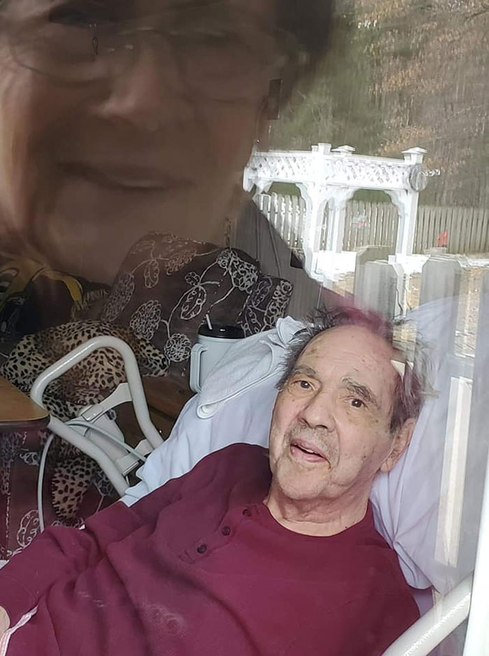 My Parents Looking At Each Other's Thru The Window Of The Nursing Home Where My Dad Is