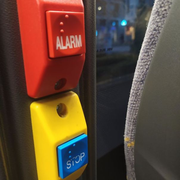 "The Braille On The ""Alarm"" And ""Stop"" Button On This Bus Are The Same"
