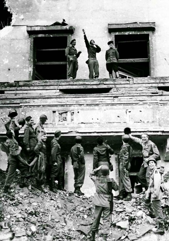 Allied Soldiers Mock Hitler Atop His Balcony At The Reich Chancellery, 1945