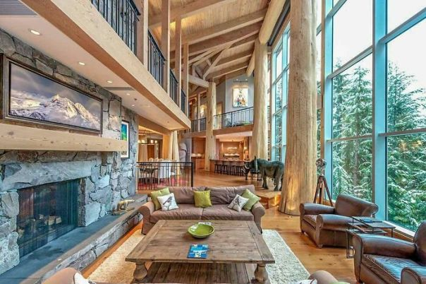 Living Area With A Glass Wall And Cedar-Log Posts And Beams In This Ski Retreat Located In Whistler, British Columbia
