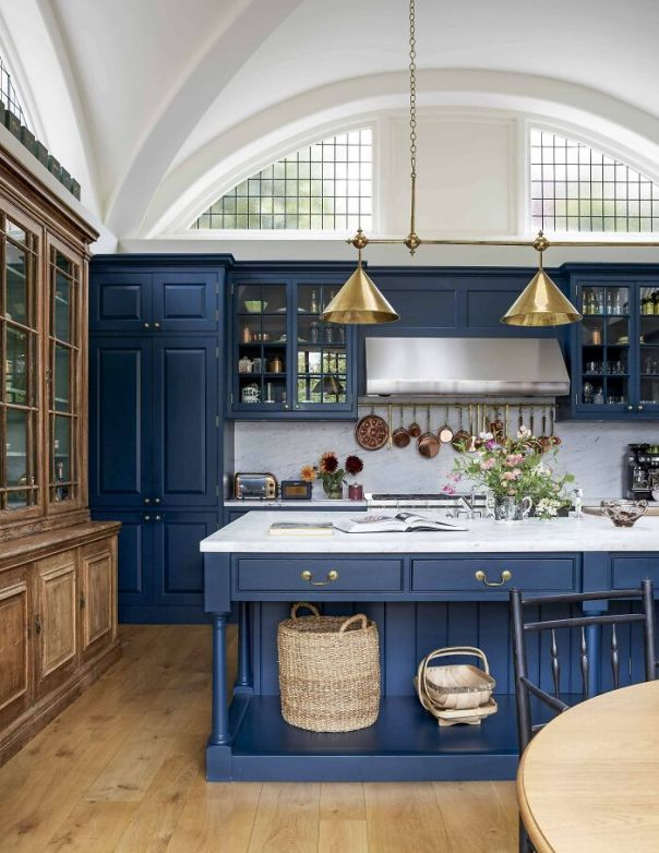 Blue Cabinetry Kitchen With A Vaulted Ceiling And Arched Clerestory Windows In An 1910s Arts And Crafts Styled House, North London, UK