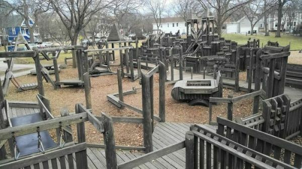 Wooden Playground: Despite Scorching Hot Metal Slides And Rubber Bridges - We Always Went Back For More...