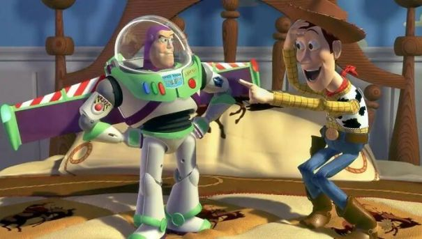 If Buzz Lightyear Doesn't Think He's A Toy, Why Does He Freeze Up When Humans Are Around In Toy Story (1995)?