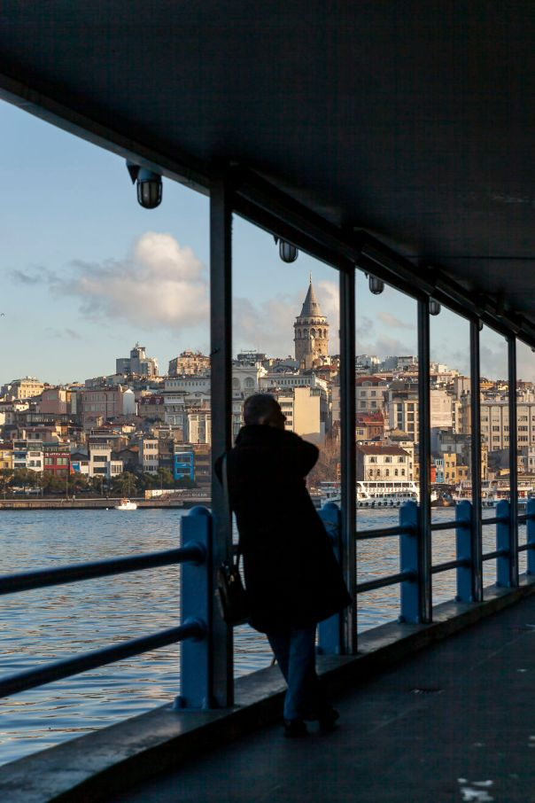 Galata Tower Is One Of My Favorite Places In Istanbul. I Have Many Shots Of It From Different Angles, At Different Light Conditions. In This Case, I Took It From The Bridge Walkway And I Like The Framing Of The Man And The Tower