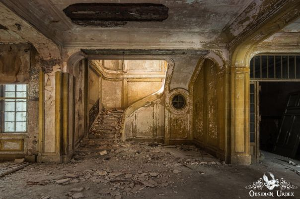 Yellow Paint Still Clings To This Stairway, As Concrete And Plaster Crumble