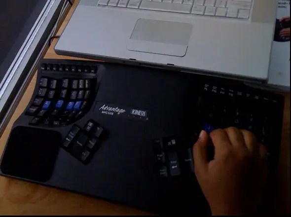 The standard issue keyboard is a Dell, but many opt for a Kinesis keyboard like this.