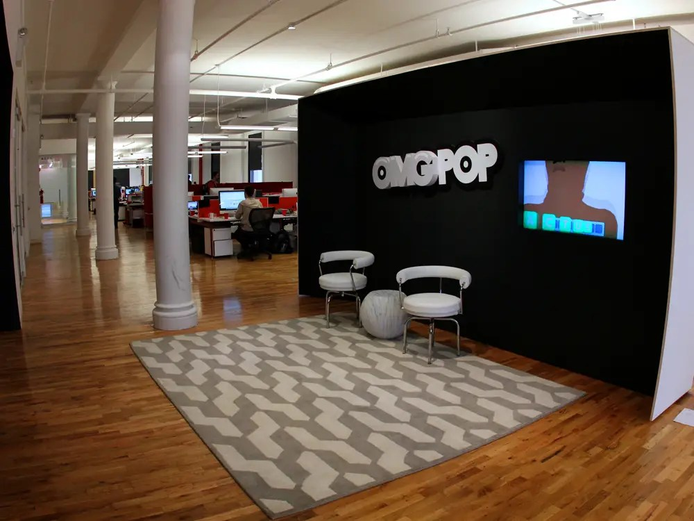 You are greeted in the office by this seating area with the OMGPOP logo and a video demo of the company's wunderkind game Draw Something.