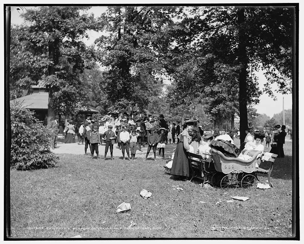 PLAY DATE: Children frolic and play around at Belle Isle Park in 1905. The women are wearing fine dresses as they push fancy looking carriages.
