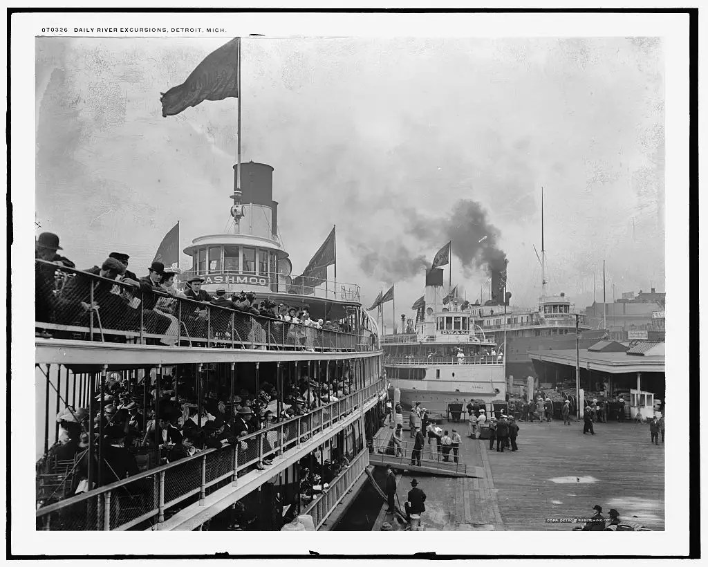 BUSY DAY AT THE HARBOR: The wharf was already bustling in 1901 when steam ships Tashmoo and Idlewild came in as spectators look at these massive steam machines.