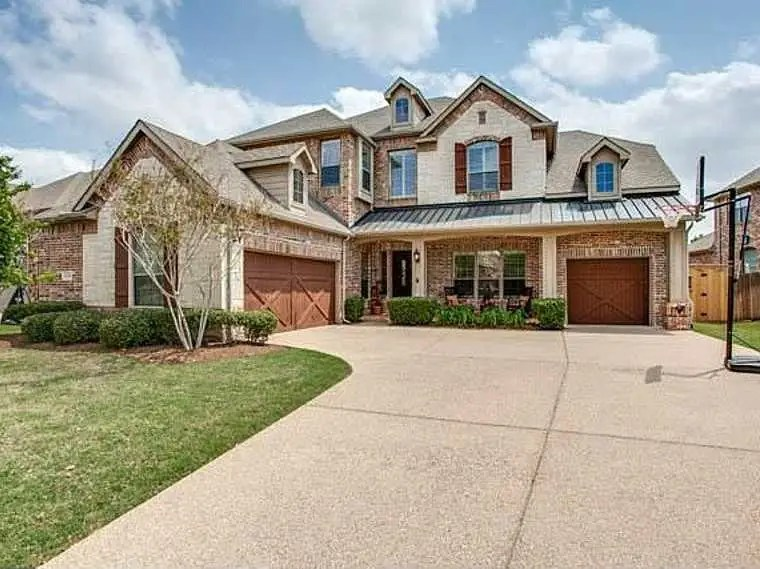 FRISCO, TX: $475,000 will get you four bedrooms in a 4,235-square-foot house with a split three-car garage, custom painted cabinets, and an oversized stamped concrete patio.