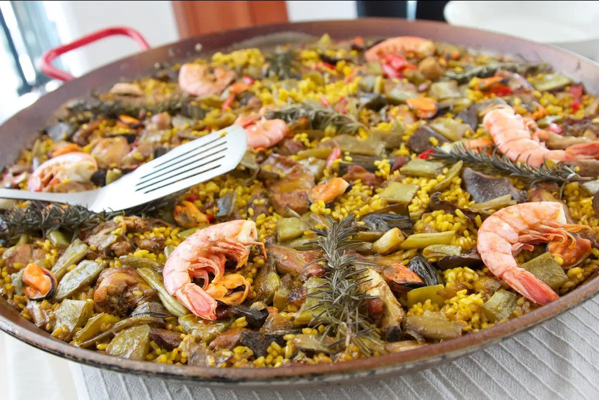 share-a-pot-of-paella-saffron-infused-rice-with-seafood-and-chorizo ...