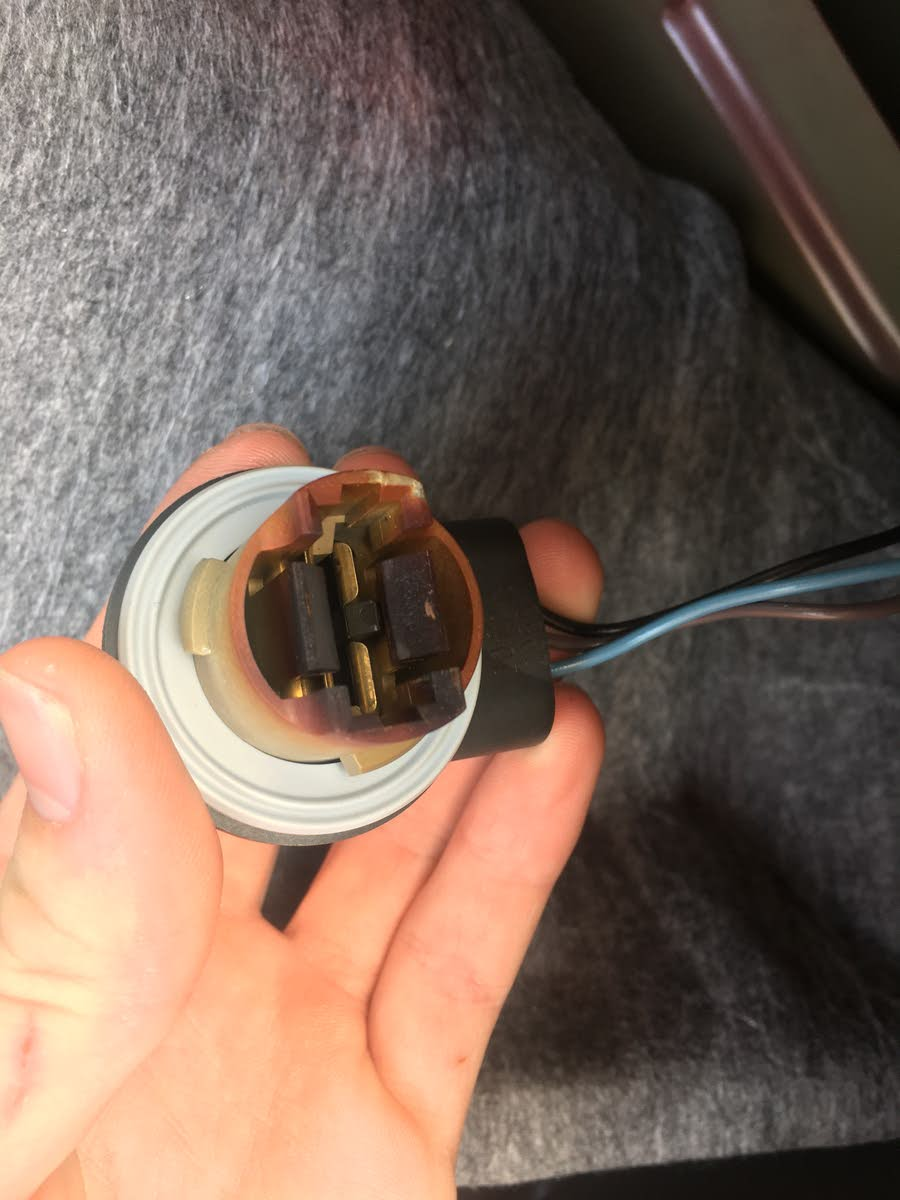 medium resolution of one thing is that the socket that the bulb goes in looks sort of burned or blacked how do i know what to fix should i replace the whole socket piece
