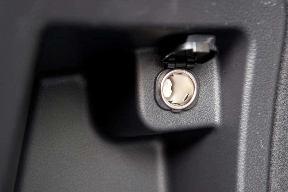 medium resolution of up close view of a 12 volt power outlet in a car