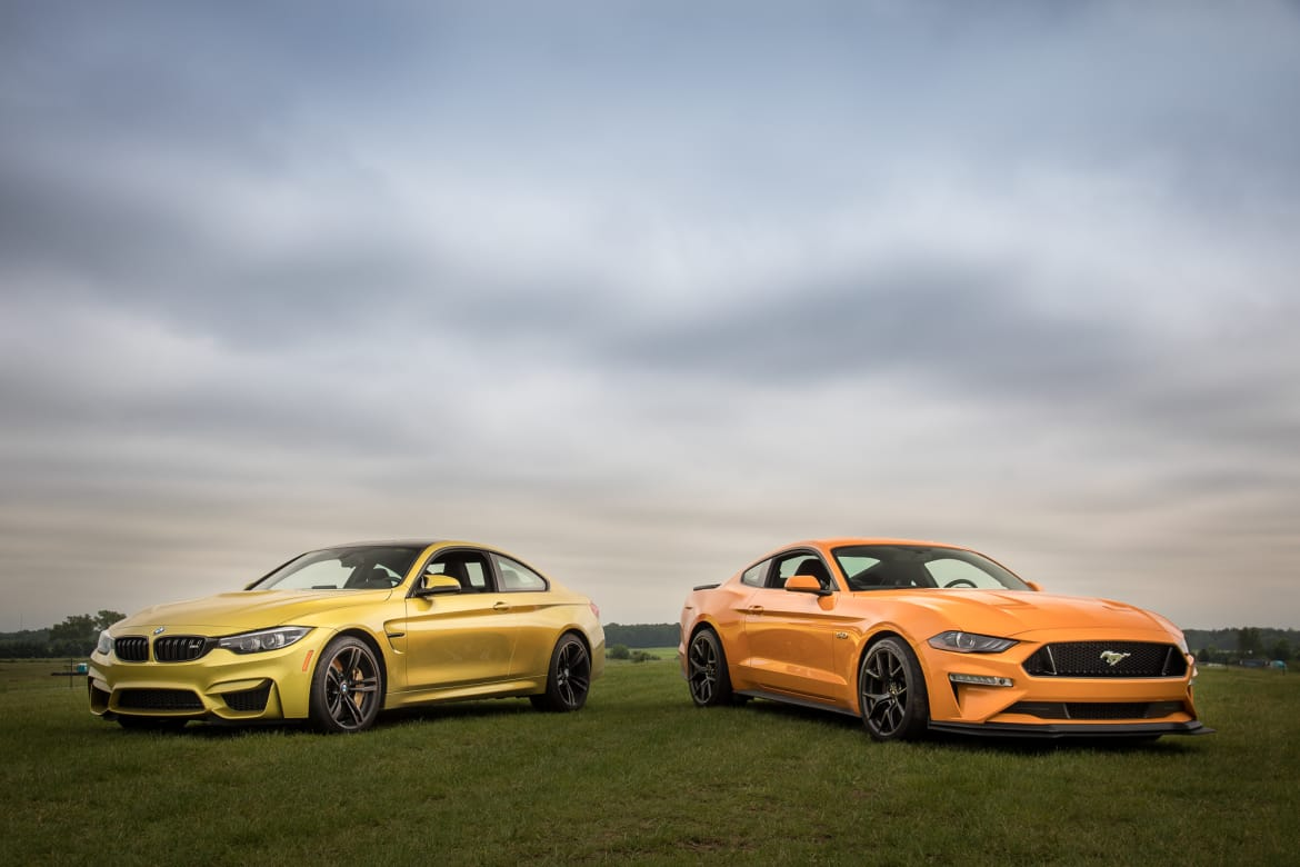 hight resolution of 01 bmw m4 2018 vs ford mustang gt