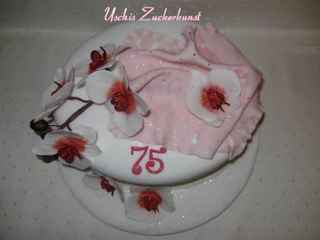 Edle Orchideetorte mit rosa Spitzentuch zum 75