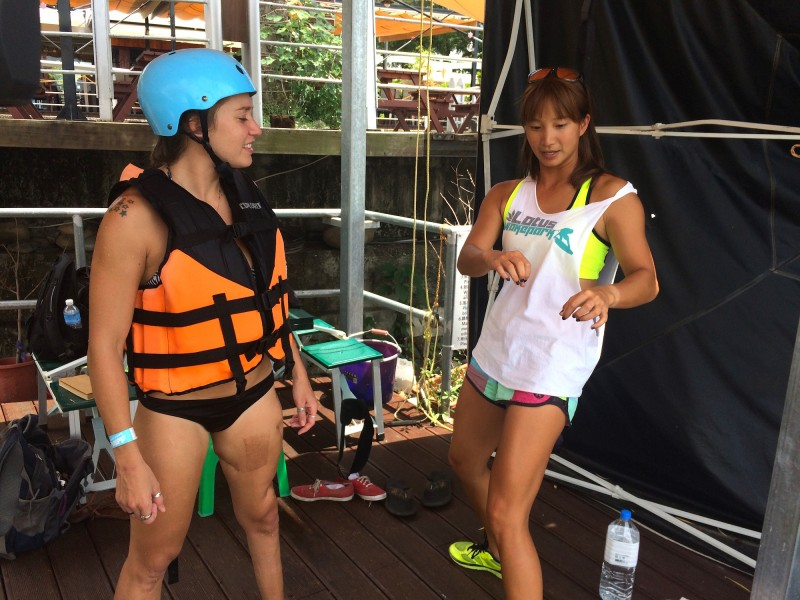 Shannon Teng instructs visitor Danielle Press on how to maneuver a wakeboard.