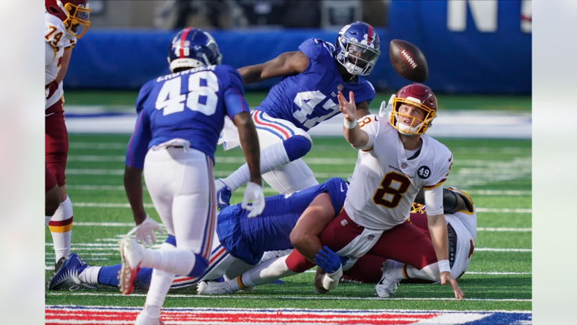 Washington Football Team quarterback Kyle Allen (8) loses control of the ball during the second half of an NFL football game Sunday, Oct. 18, 2020, in East Rutherford, N.J. New York Giants linebacker Tae Crowder (48) recovered the ball and scored a touchdown on the play. (AP Photo/John Minchillo)