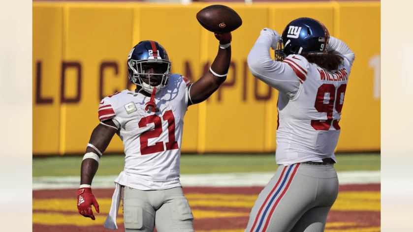 New York Giants safety Jabrill Peppers (21) celebrates with New York Giants defensive end Leonard Williams (99) during an NFL football game against the Washington Football Team on Sunday, November 8, 2020 in Landover, Maryland. (Mikey Owens/NFL)