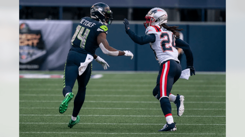 New England Patriots defensive back Stephon Gilmore covers Seattle Seahawks wide receiver DK Metcalf during the first half of an NFL football game, Sunday, Sept. 20, 2020, in Seattle. (AP Photo/Stephen Brashear)