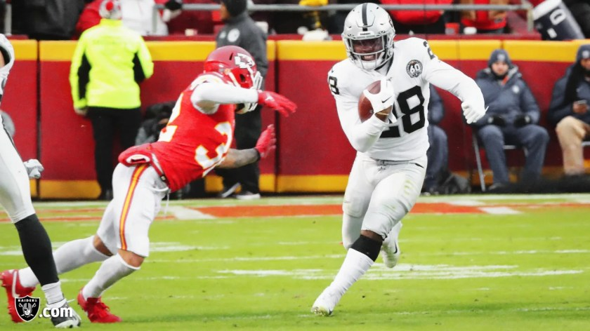 Raiders running back Josh Jacobs (28) rushes during the regular season game against the Kansas City Chiefs.