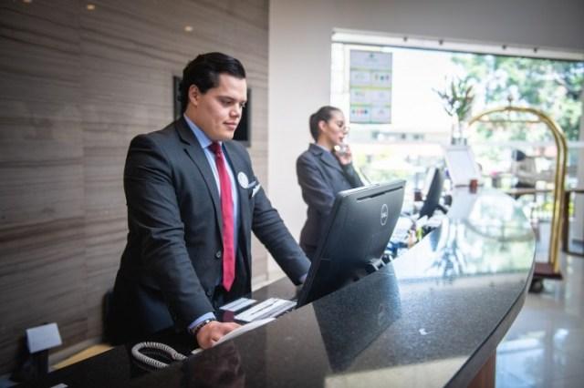 Receptionist-Work-Attention-Man-Reception-Hotel-5975961.jpg