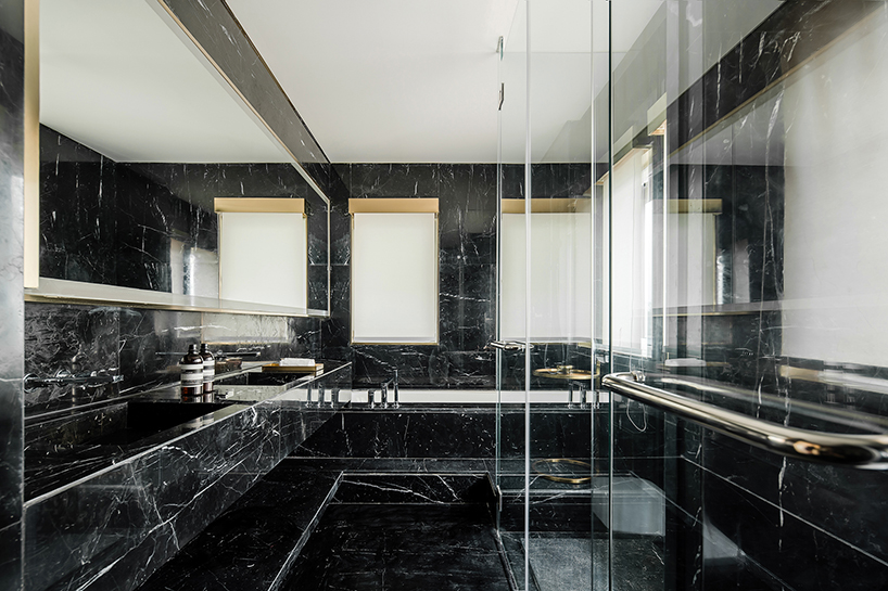 co-direction uses marble and bronze stainless steel to create exquisite interior in china
