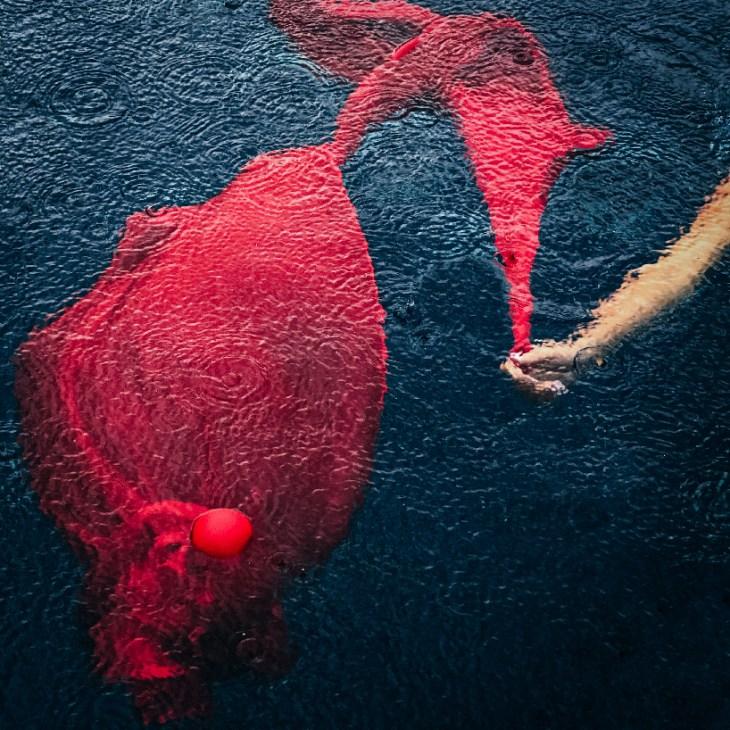 emilie möri captures the fluid movement of fabric under the monsoon rains of thailand designboom
