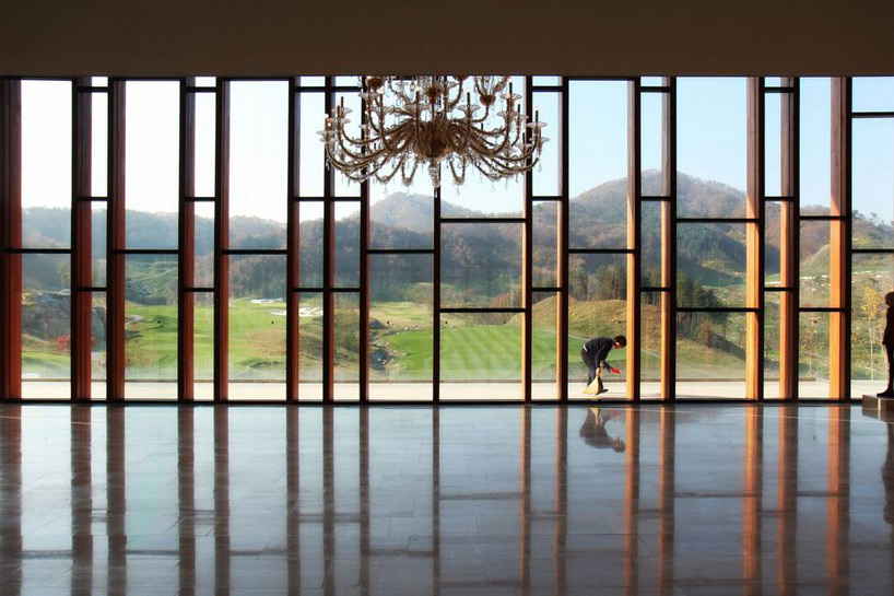 whistling rock golf clubhouse in scenic korean landscape