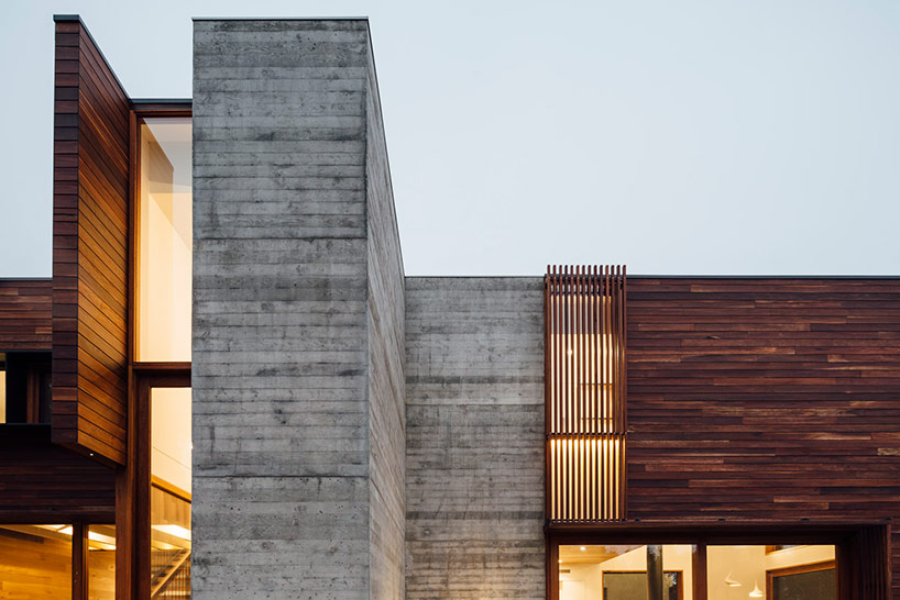 maloney architects constructs the invermay house of concrete wood and glass