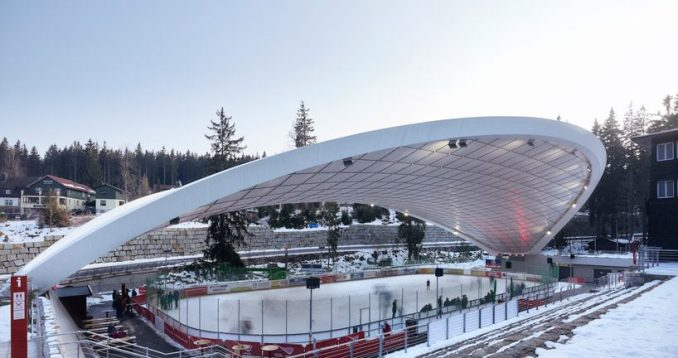 graft constructs dramatic curved roof over feuerstein arena in germany
