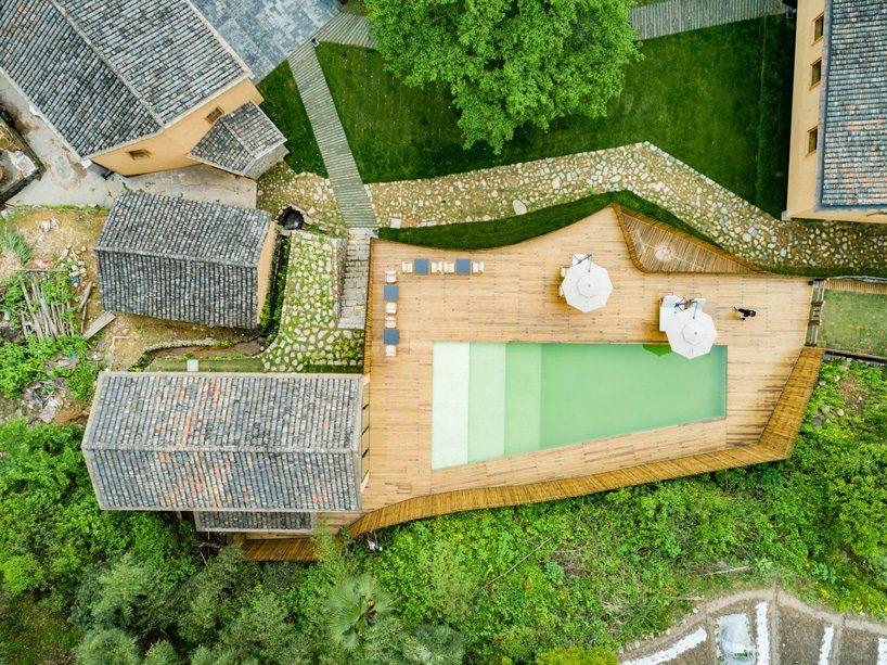 kooo architects rebuilds 'origin villa' hotel in rural china using bamboo, stone + charred wood