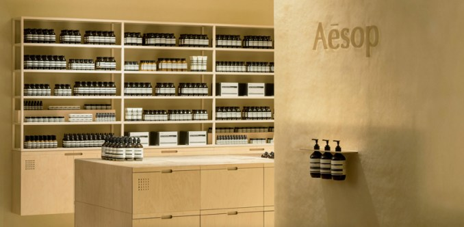 schemata architects creates 'soft beige mirage' inside aesop store in japan