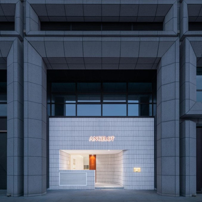 say architects clads angelot patisserie in hangzhou in a curved tile façade