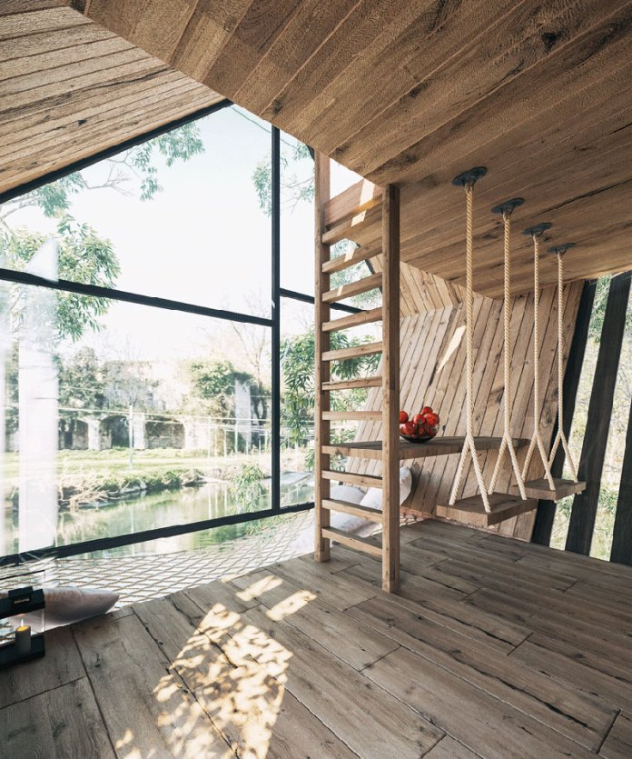 Treehouse mods around a serene lake in France make you feel like you are floating on water