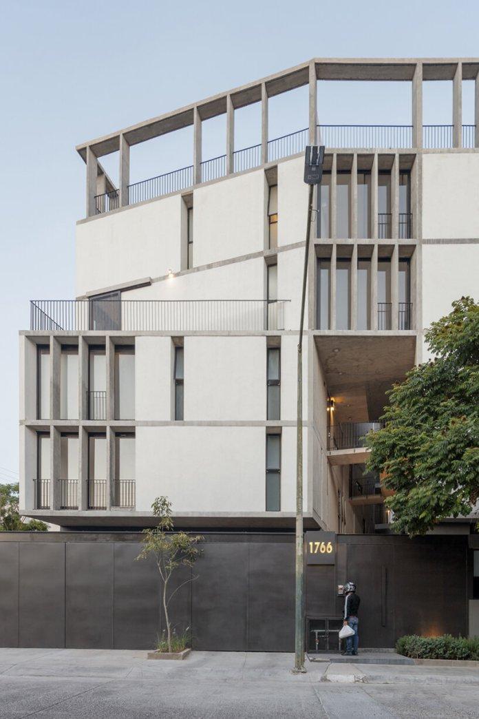 em-estudio shades its 'RD 1766' apartments in guadalajara with a ribbed facade
