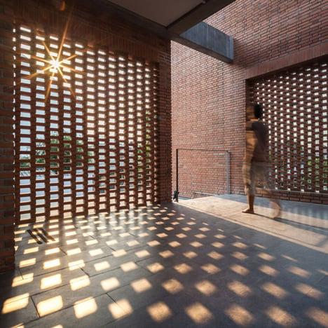 Brick grates are set into the walls of this Bangkok house