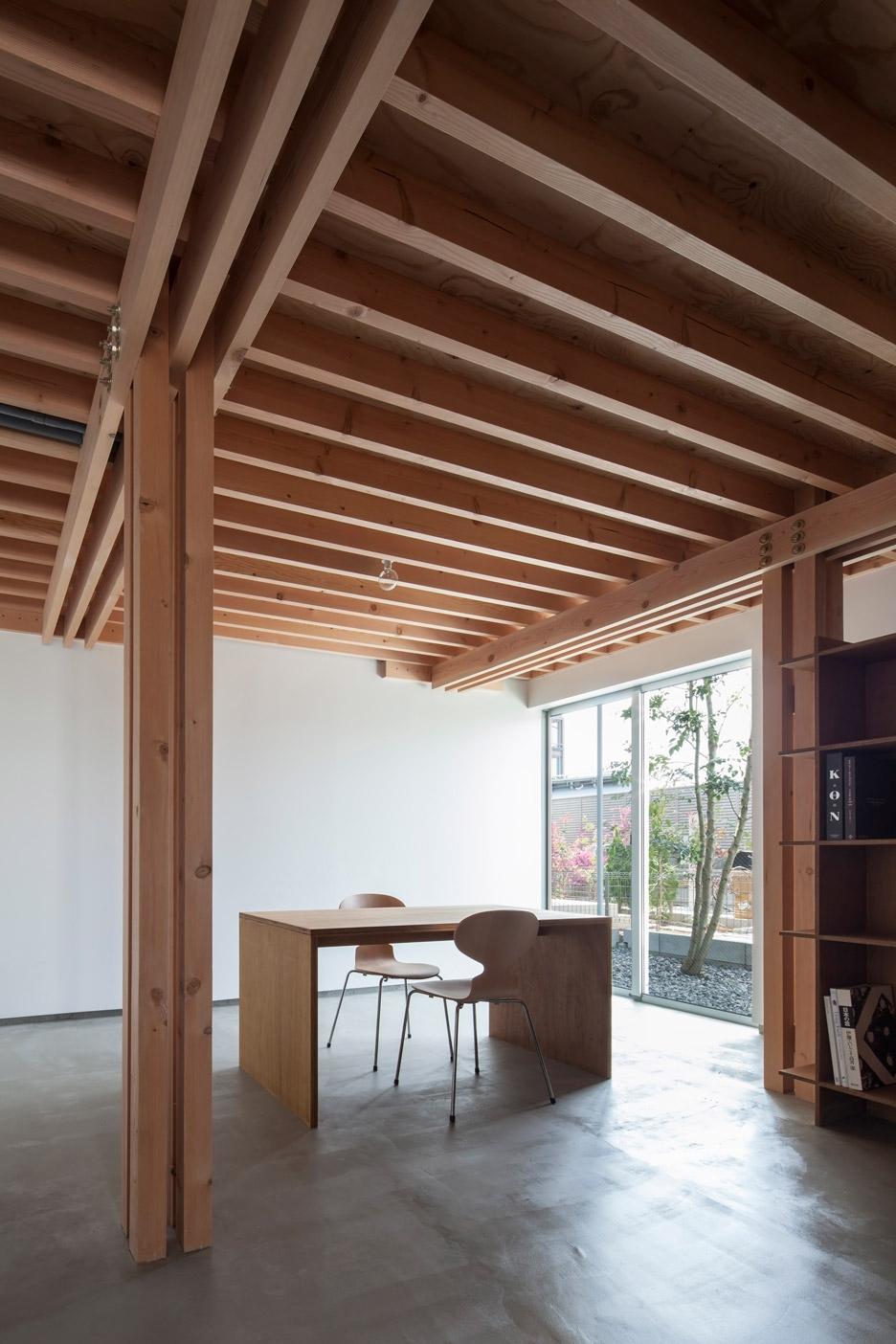 FT Architects 4 Columns house features a timber frame
