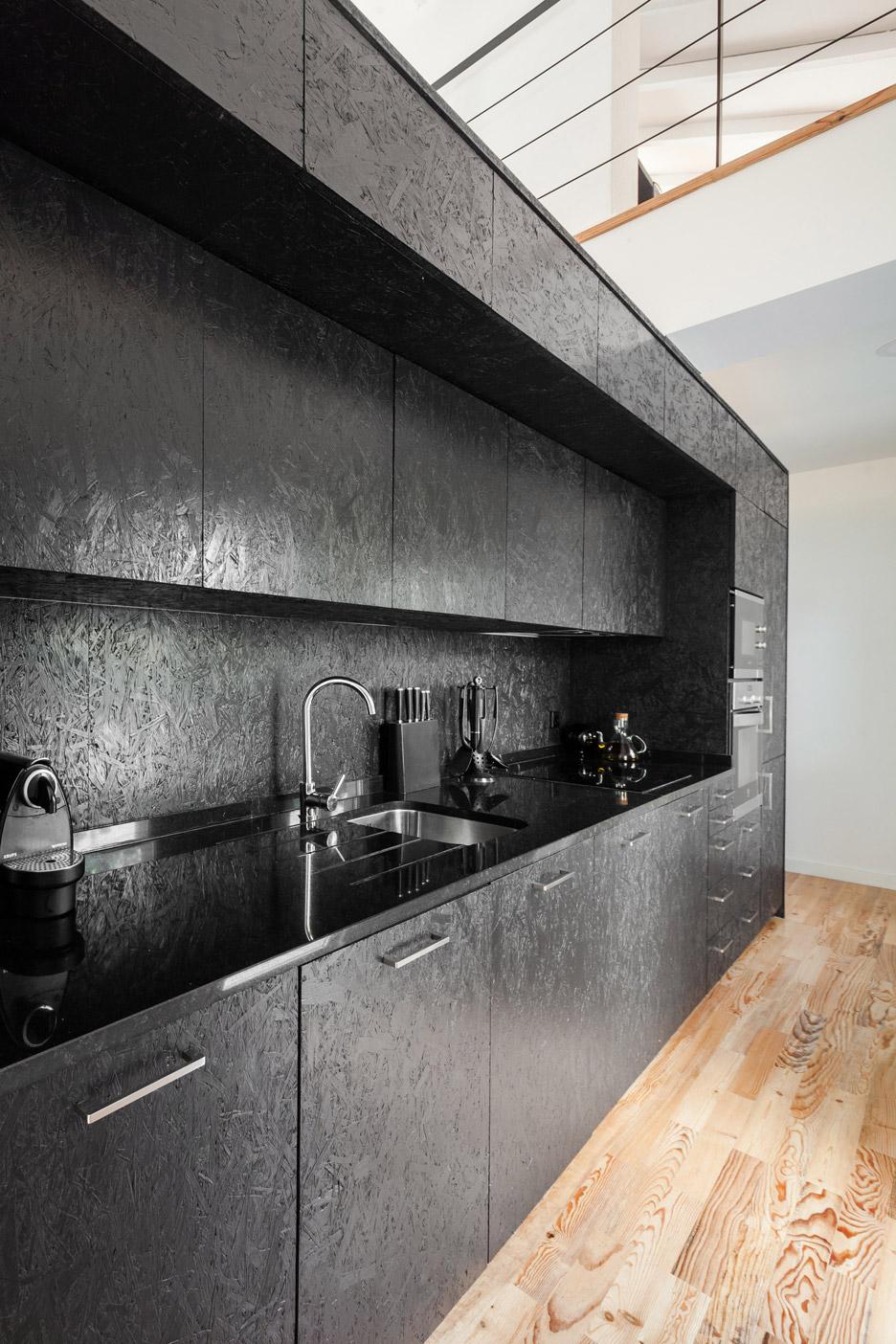 Ins Brando installs black box of rooms inside converted barn