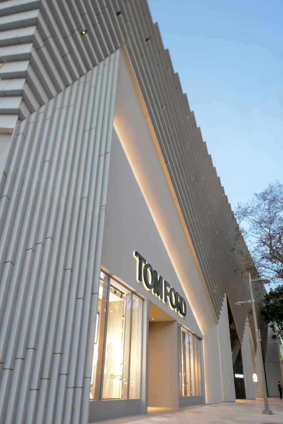ArandaLasch adds pleated concrete facade to Tom Ford store