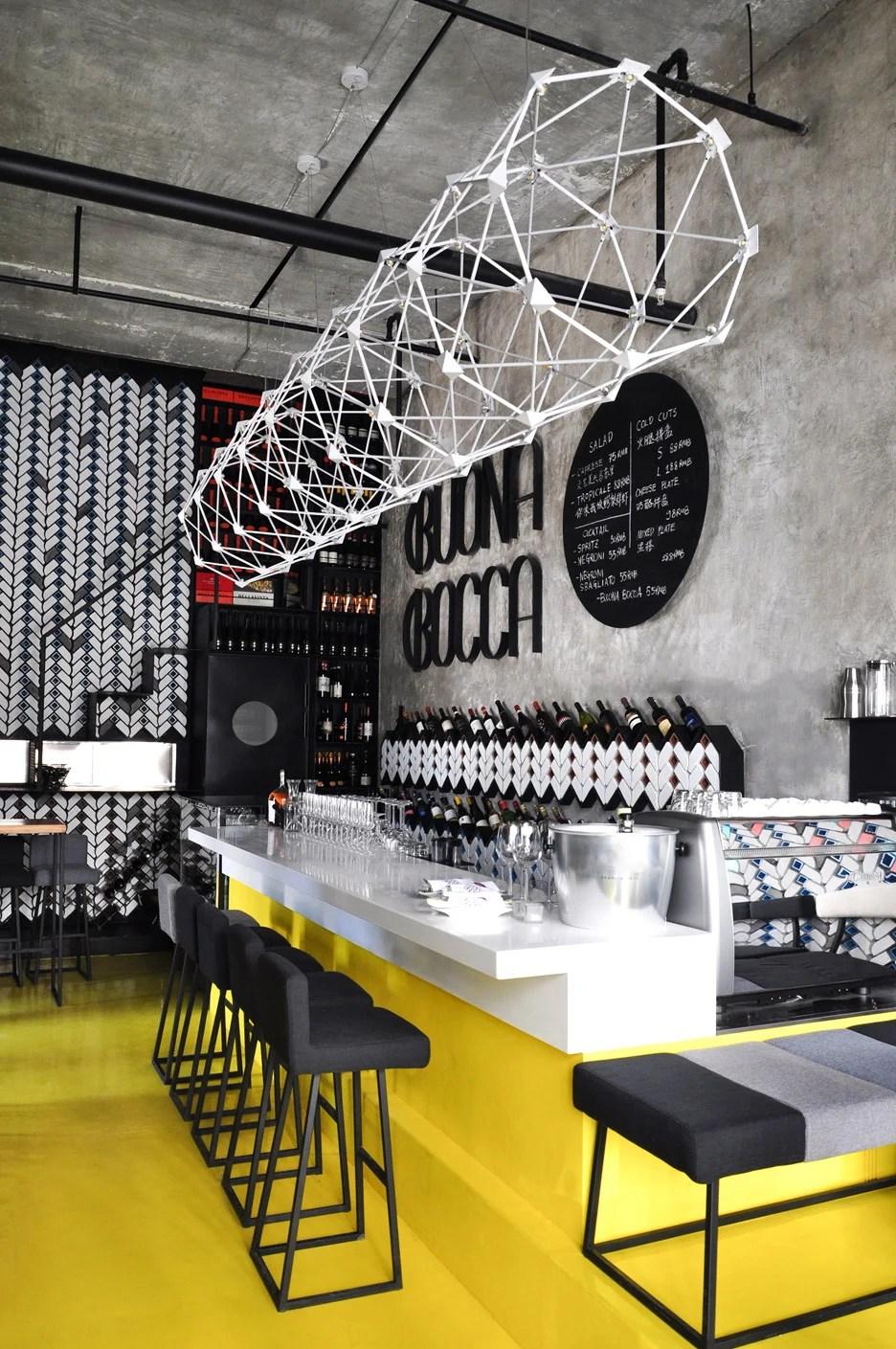Beijing bar by Studio Ramoprimo has chevronpatterned walls