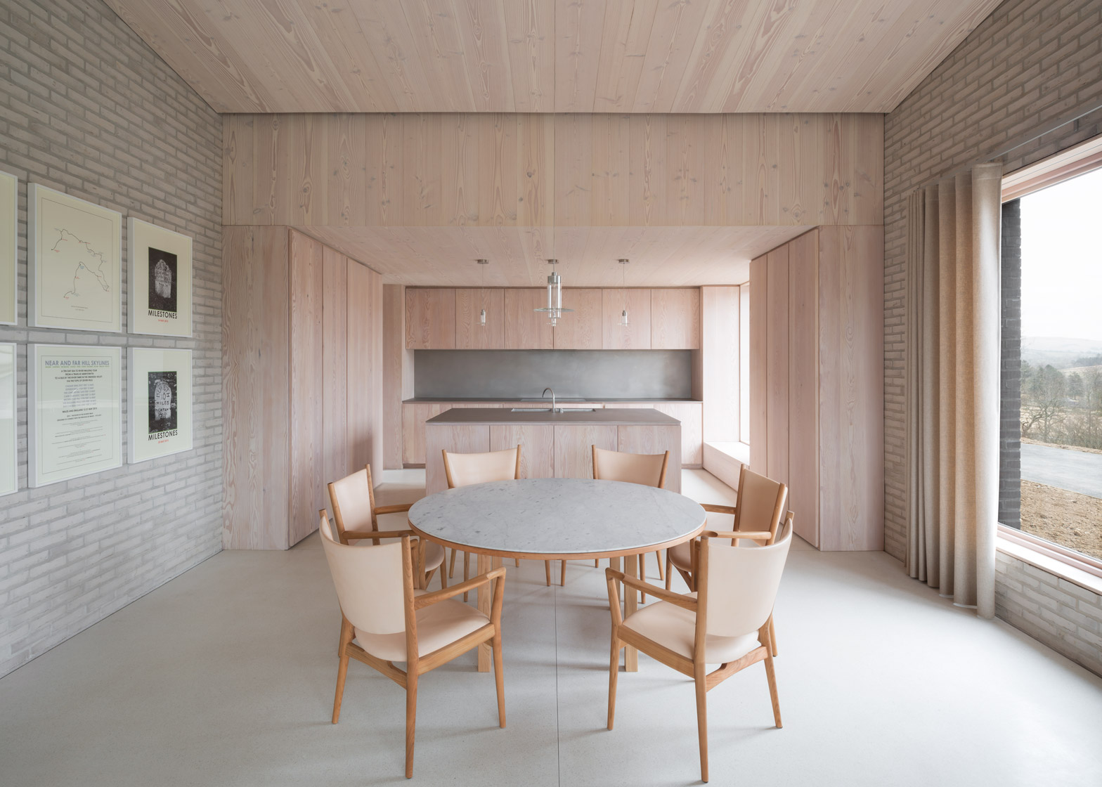 John Pawsons Life House is built from dark and light bricks