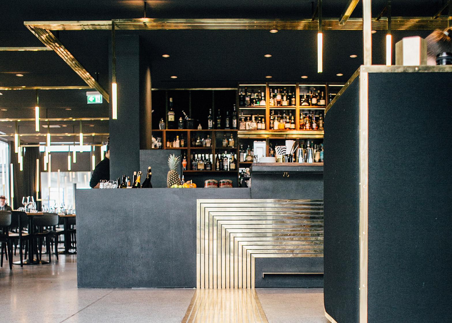 Build Inc Architects adds brass veins to Munich bar interior