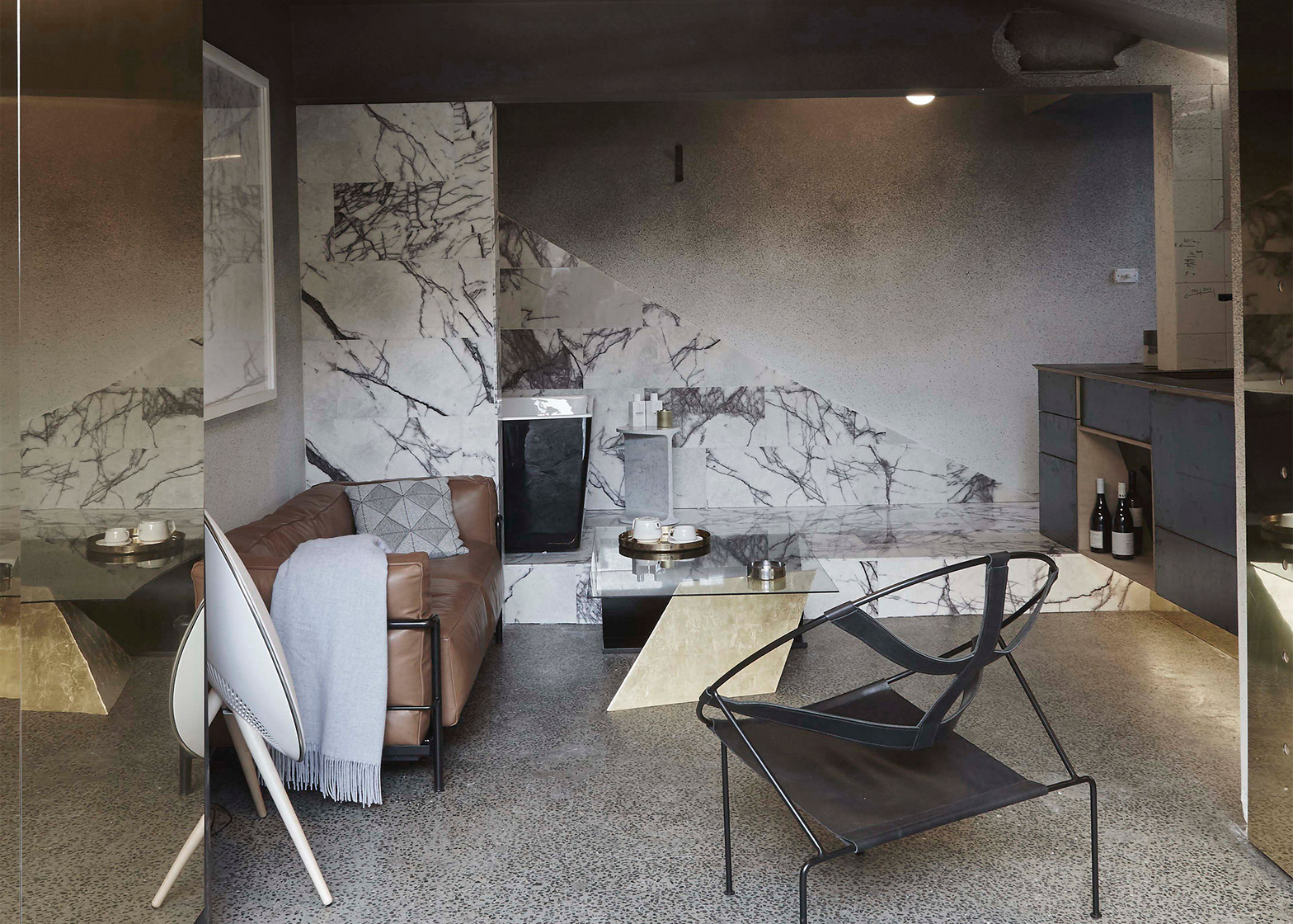 Guests buy furniture inside Microluxe flat by Edwards Moore