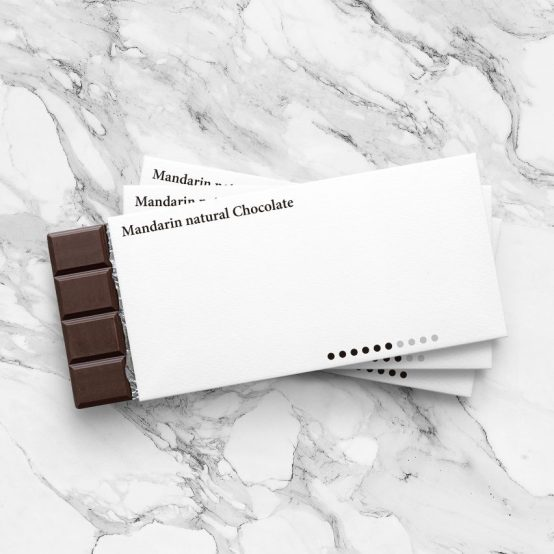Minimalist chocolate bar packaging. These custom chocolate boxes are nearly completely covered in white space.