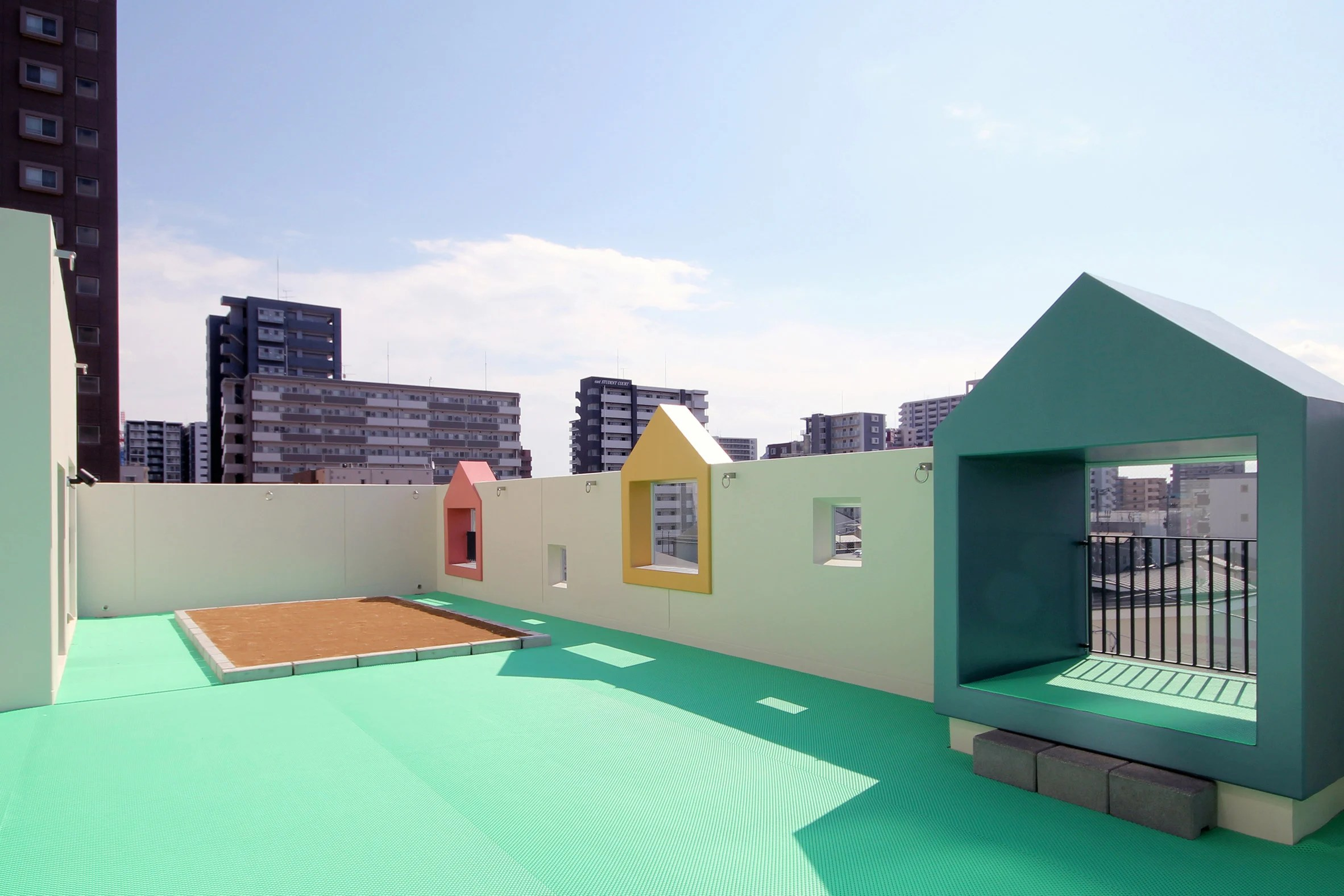 Colourful house-shaped boxes surround windows at nursery ...
