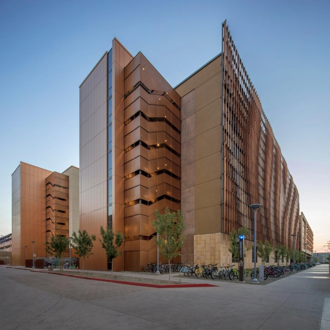 Sandstone And Metal Louvres Wrap Massive Student Housing
