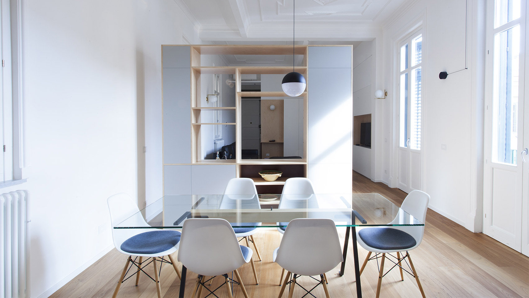 A white-walled dining room