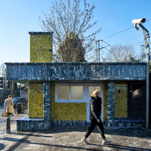 Assemble give Seven Sisters station tiled facade in tiles